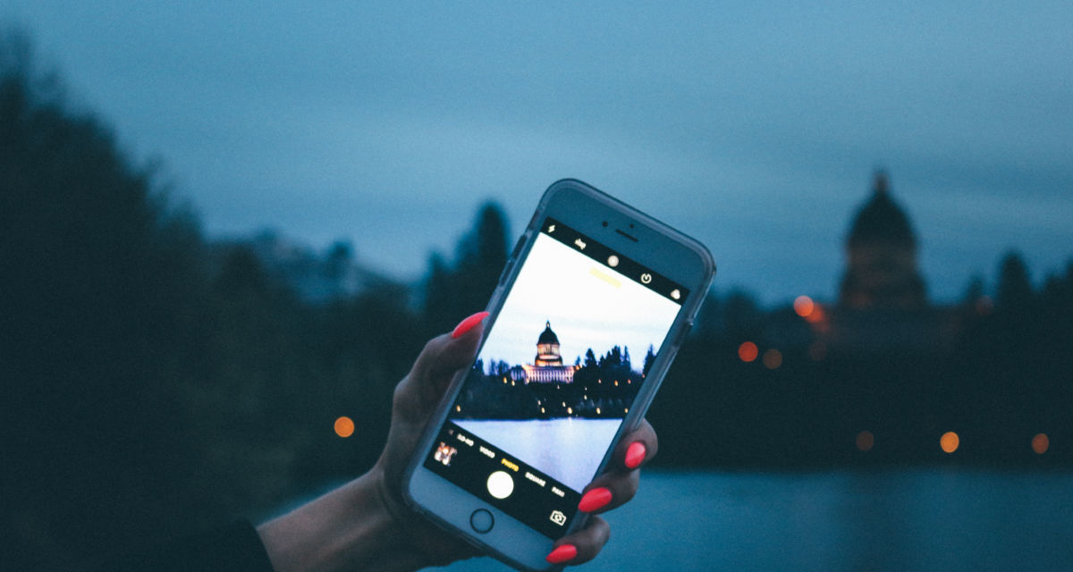 Canva Person Holding Iphone